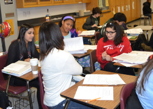 Sophomores of different backgrounds in Mr. Smith's science class talking.