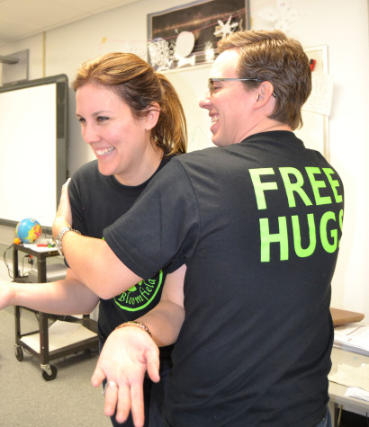 """Mr. Thomas Keegan and Ms. Kelli Tyranski participate in """"Be The Change"""" while demonstrating """"Free Hugs"""""""