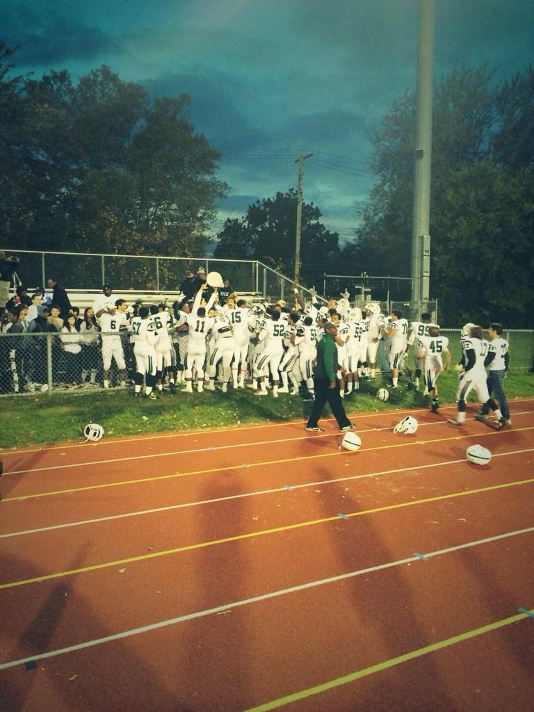 The WBHS Varsity football team celebrates a well fought victory against Southfield High School