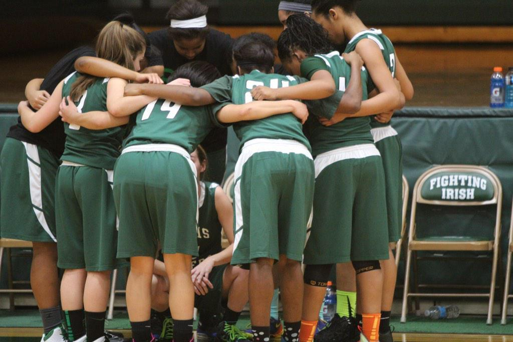 WBHS' Girls Varsity Basketball team in a huddle