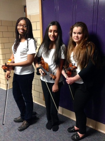 WBHS Orchestra members pose with their insturments