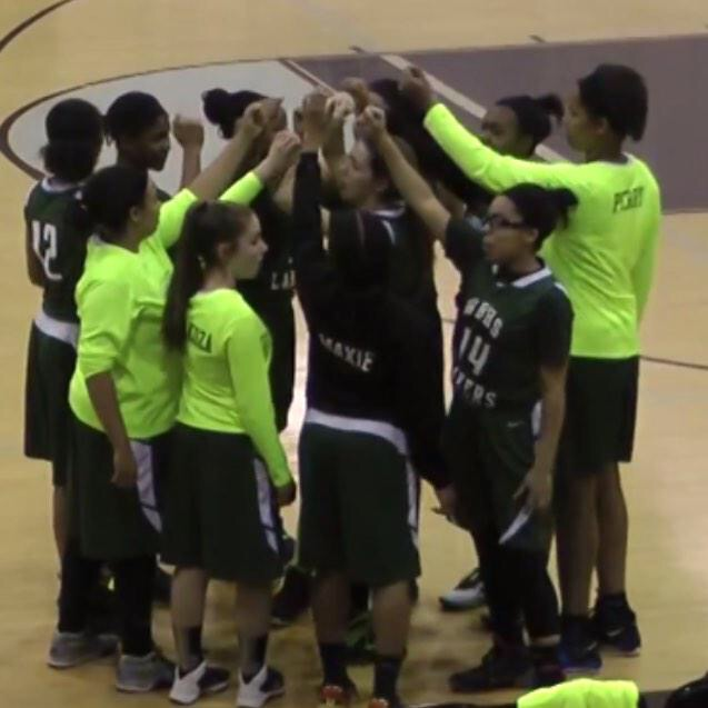 The+Girls+Varsity+Basketball+team+gathers+in+a+huddle+during+a+timeout.
