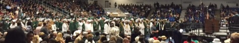 Seniors stand up for the start of the ceremony