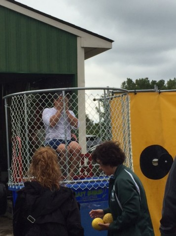 Rosevet Elementary Principal Dennis Rapal recovers from being dunked by WBSD students.