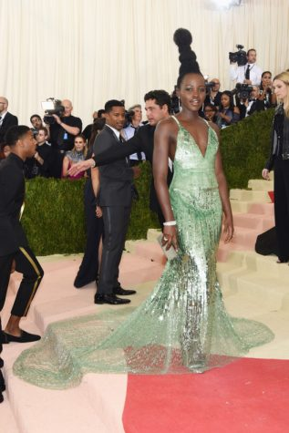 Lupita Nyong'o mesmerized attendees of this year's Met Gala with her sleek and shimmering emerald Calvin Klein Dress and African-inspired crown of glory.