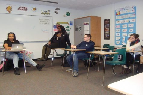 Senior Lindsey DuFresne (far right) during a Be The Change meeting.