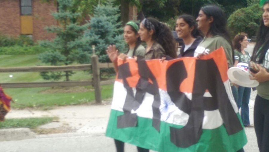 IASA members carry their banner in the homecoming parade.