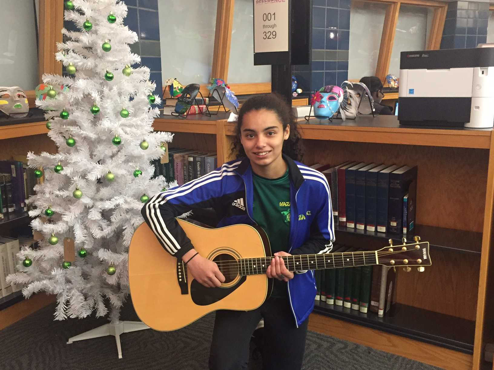 Freshman Gabby Green and her guitar at Coffee House 2016