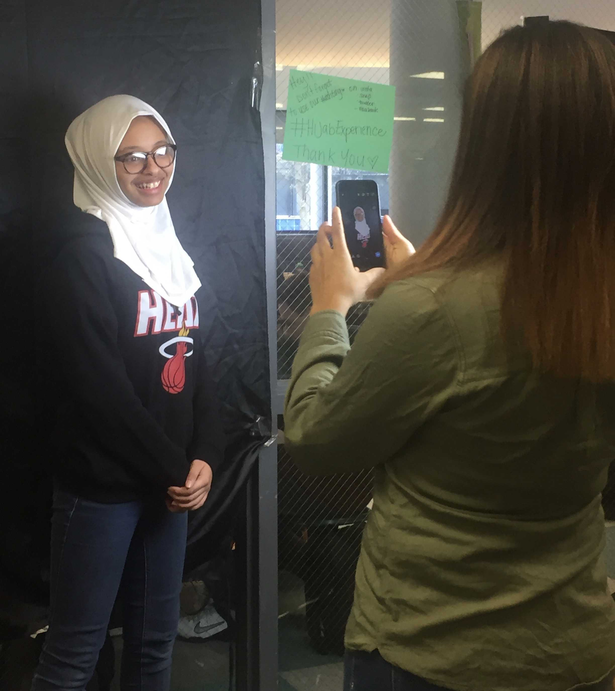 Blake+Griffin%2C+senior%2C+photographs+a+student+trying+on+the+hijab.+