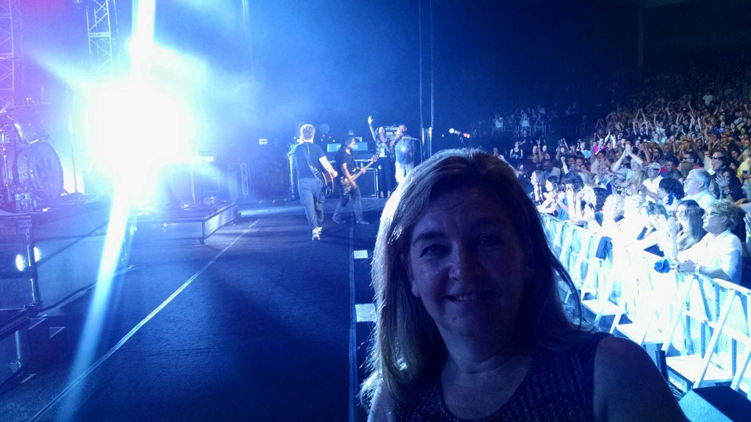 Mrs. McHardy on stage at a Goo Goo Dolls concert.