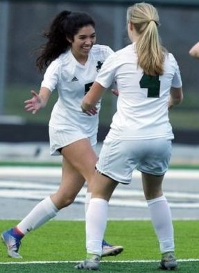 Senior Emily Falkowski (Left) congratulates sophomore Chloe Barnthouse (Right) after a great play against Clawson High School on April 23, 2018.