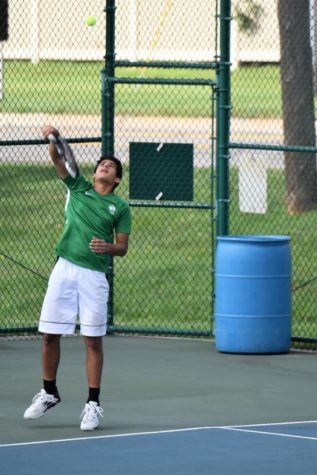 Senior Ali Hakim hitting a serve. Photo courtesy of West Bloomfield Athletics.