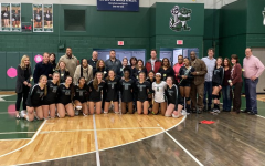 The volleyball team and their parents. Photo courtesy of West Bloomfield Athletics